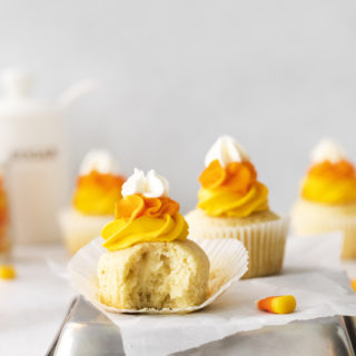 Candy corn cupcake with a bite out of it