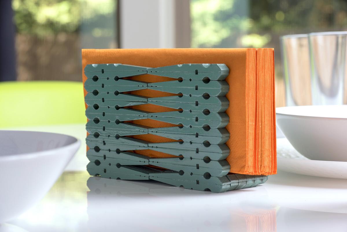 Finished clothespin napkin holder with orange napkins