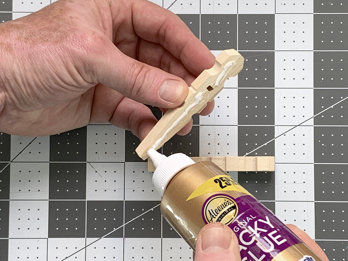 Gluing two clothespins together with craft glue