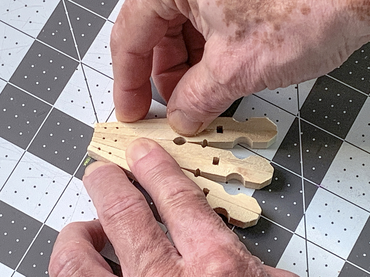 Holding clothespins together to dry