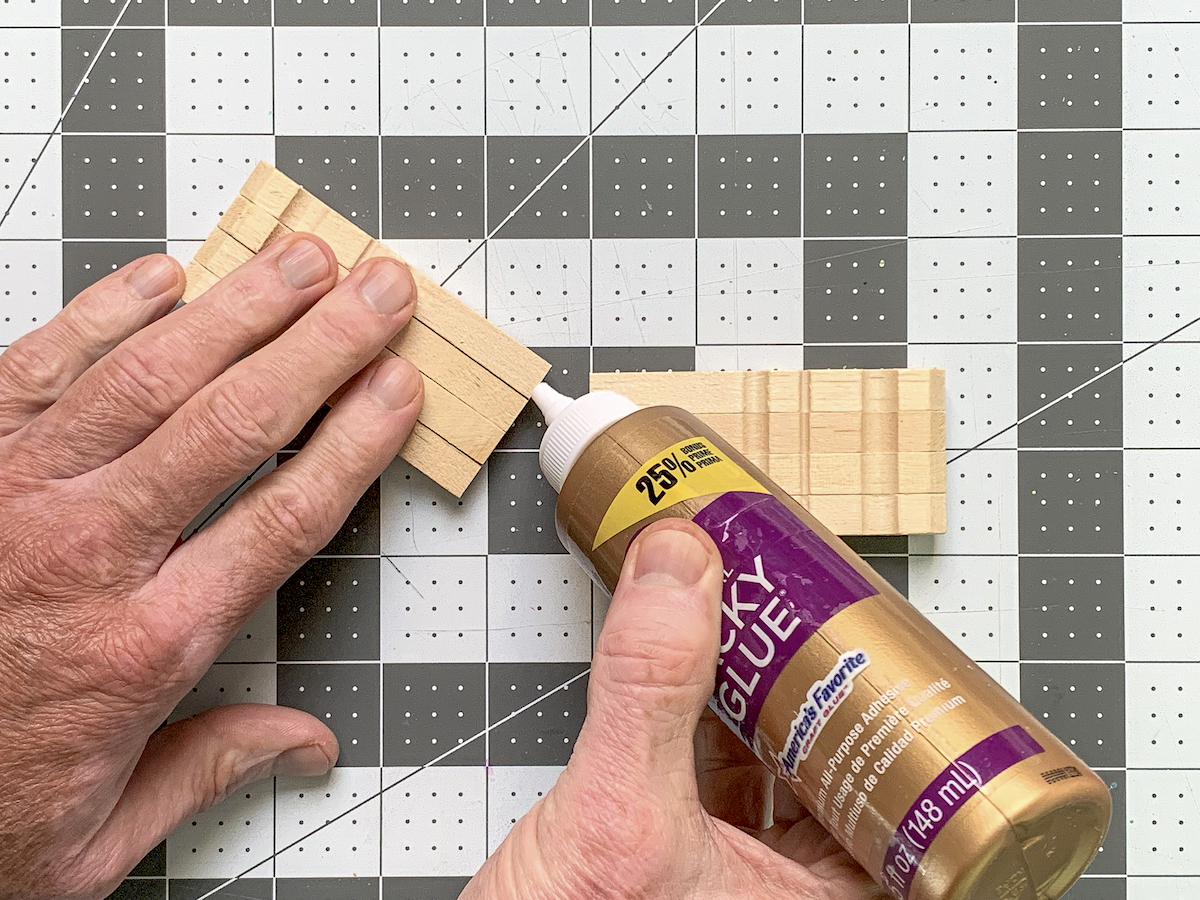 Placing glue on the edge of clothespins