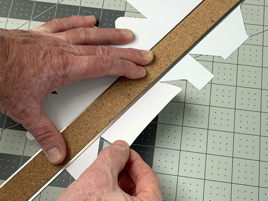 Using a ruler to fold a treat box